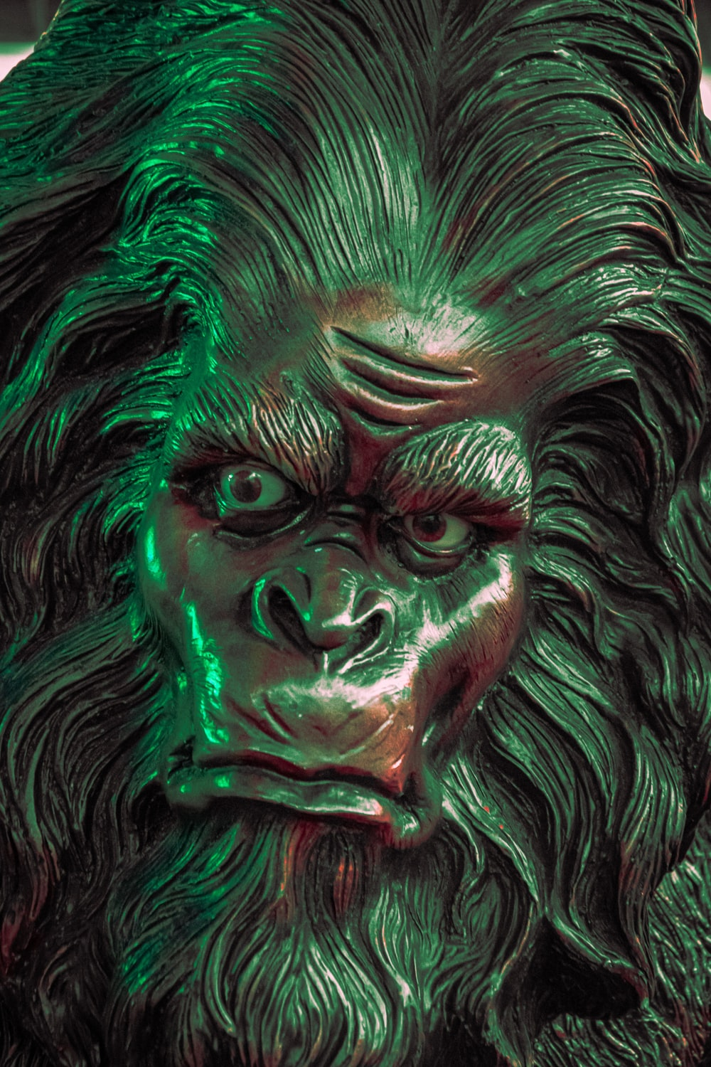 green and black lion head bust