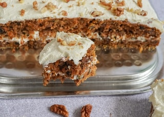 brown and white cake on clear plastic container