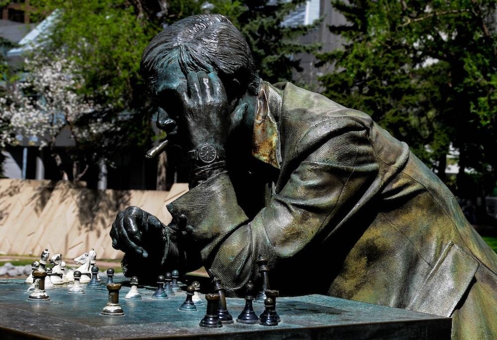 man in brown jacket statue