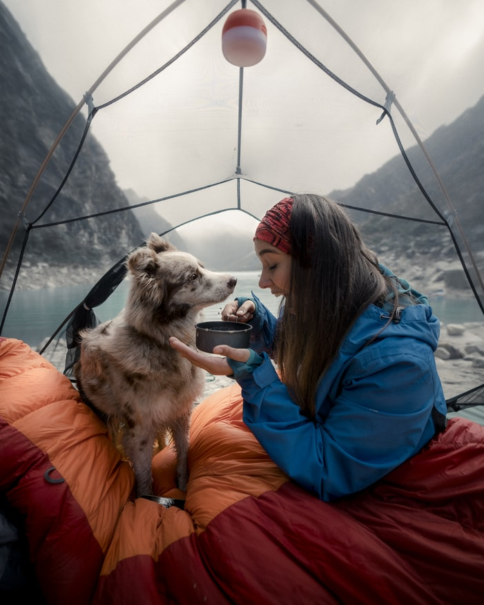 girl and dog in tent