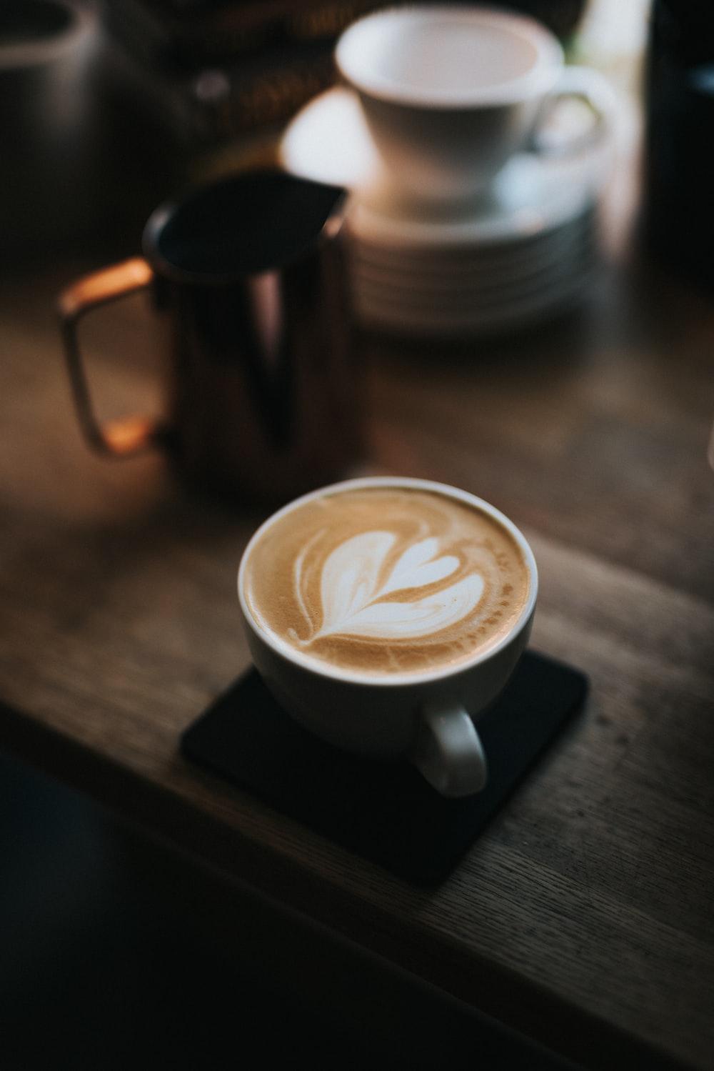 black ceramic mug with heart shaped coffee
