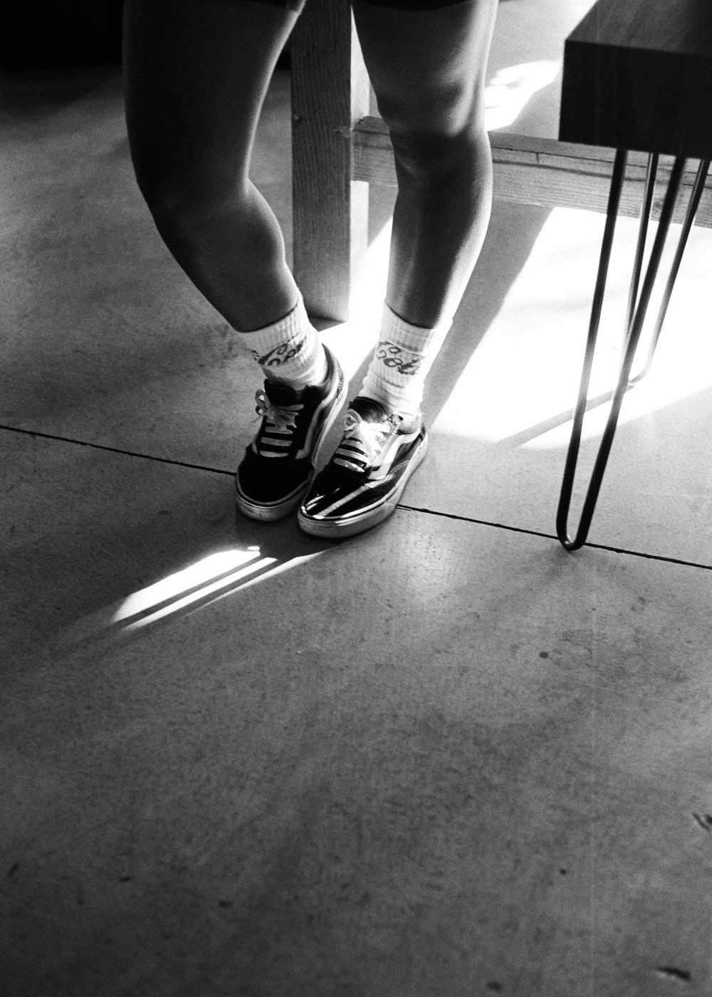 person in black and white nike sneakers