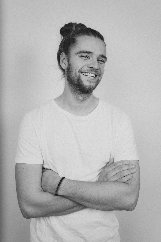 man in crew neck t-shirt smiling