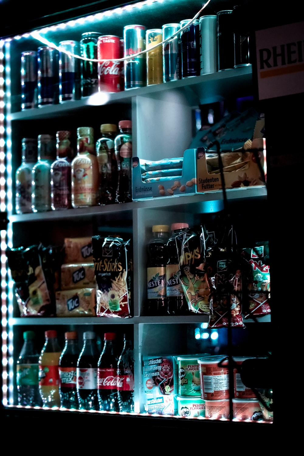 bottles on shelf with lights turned on during night time