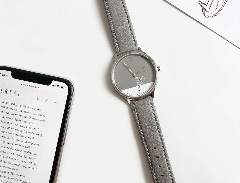 black leather strap silver round analog watch