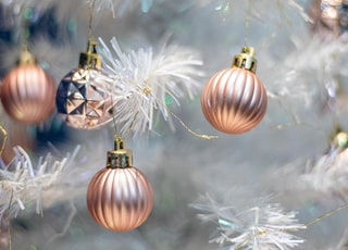 gold and silver baubles on white christmas tree