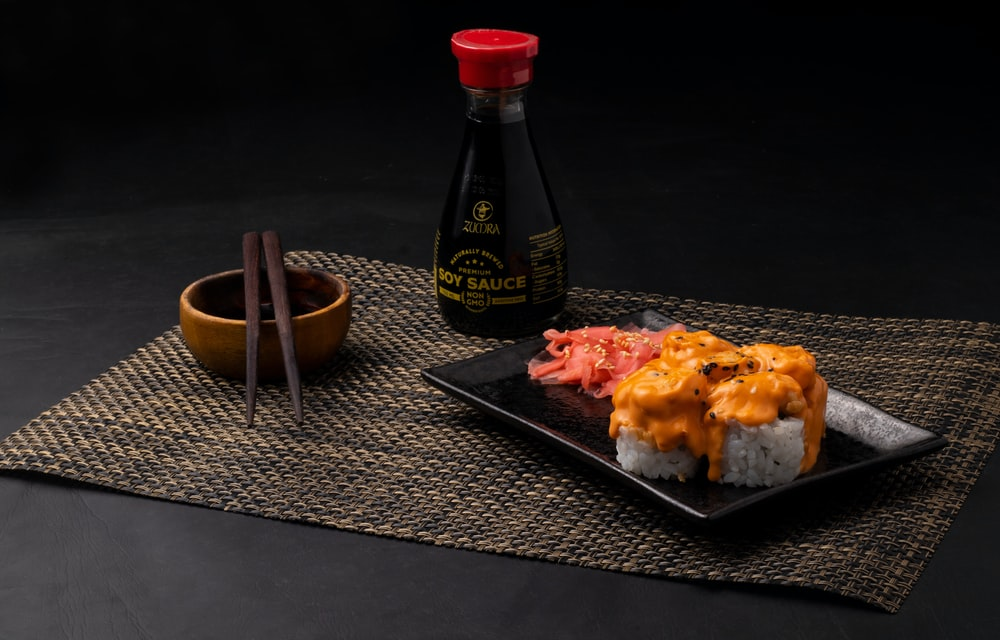 black plastic tray with food on table