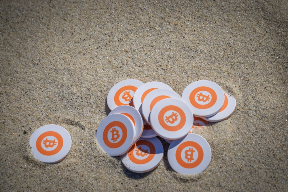 white orange and blue round buttons on brown sand