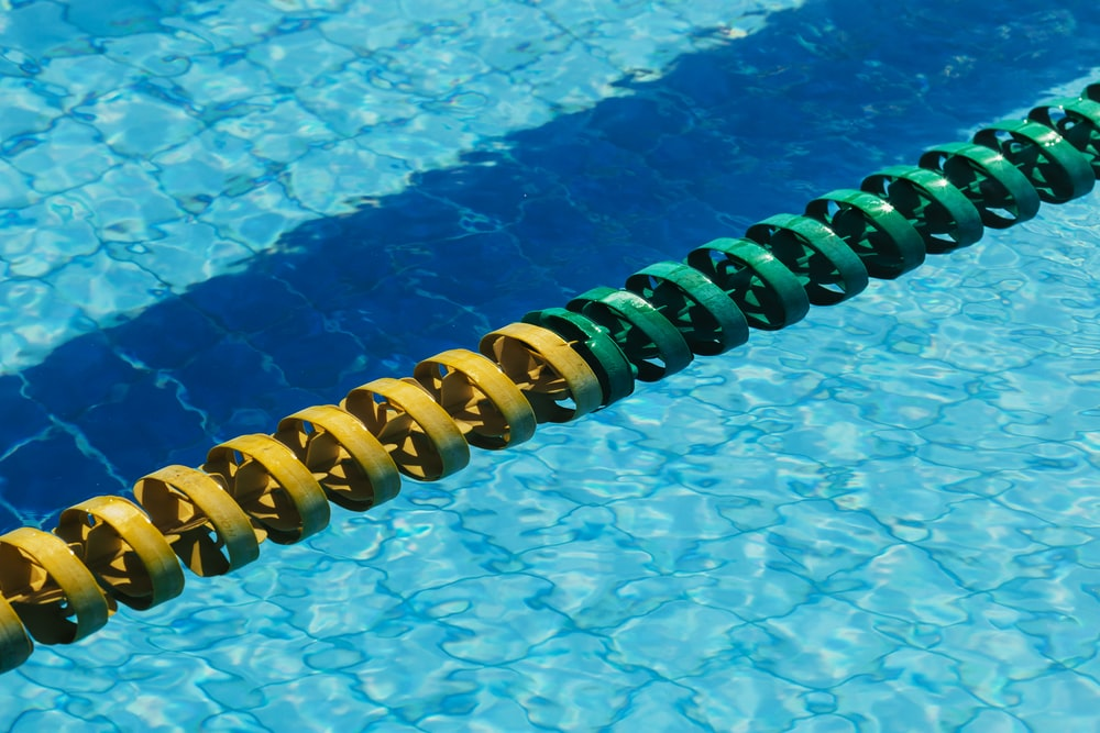 yellow and blue rubber band on swimming pool