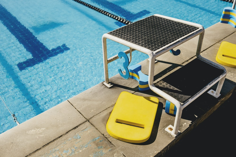 white and blue swimming pool chair