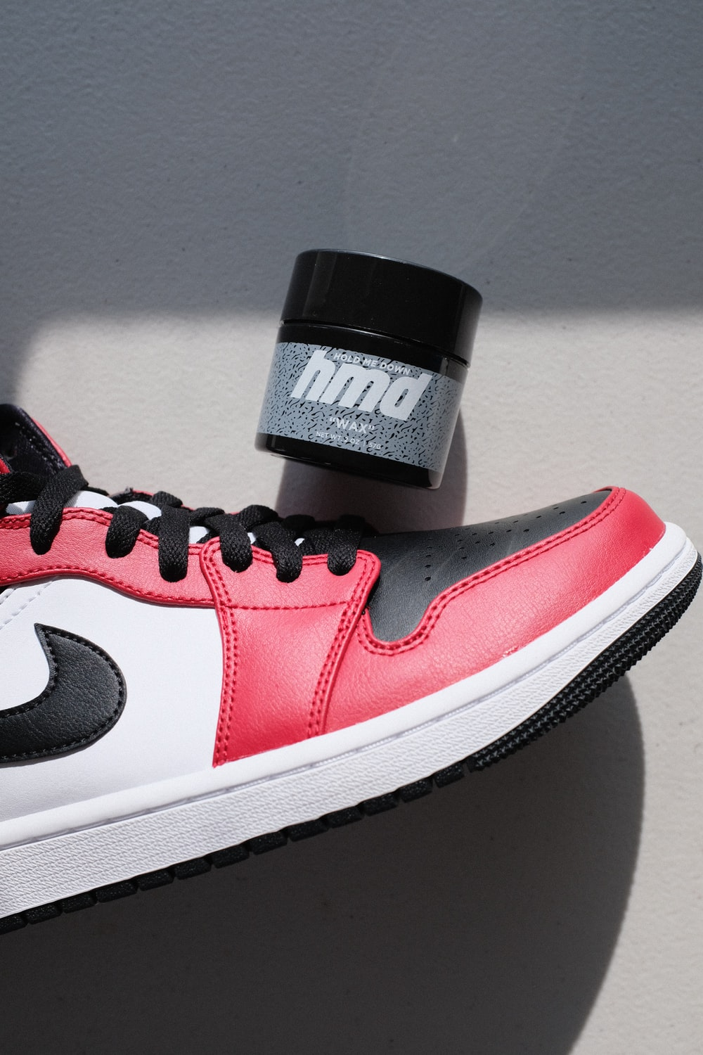 red and white nike sneaker