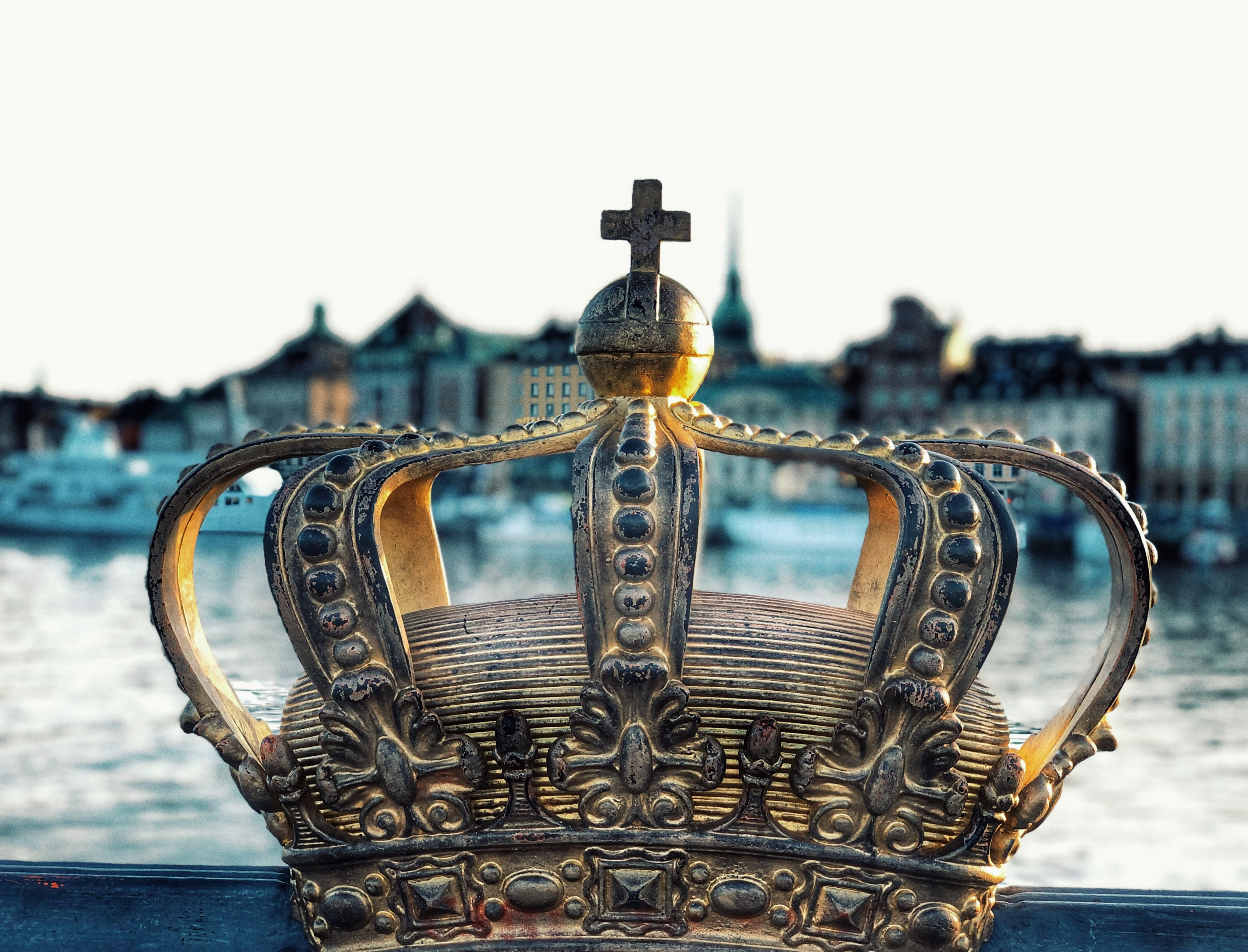 gold crown on blue body of water during daytime