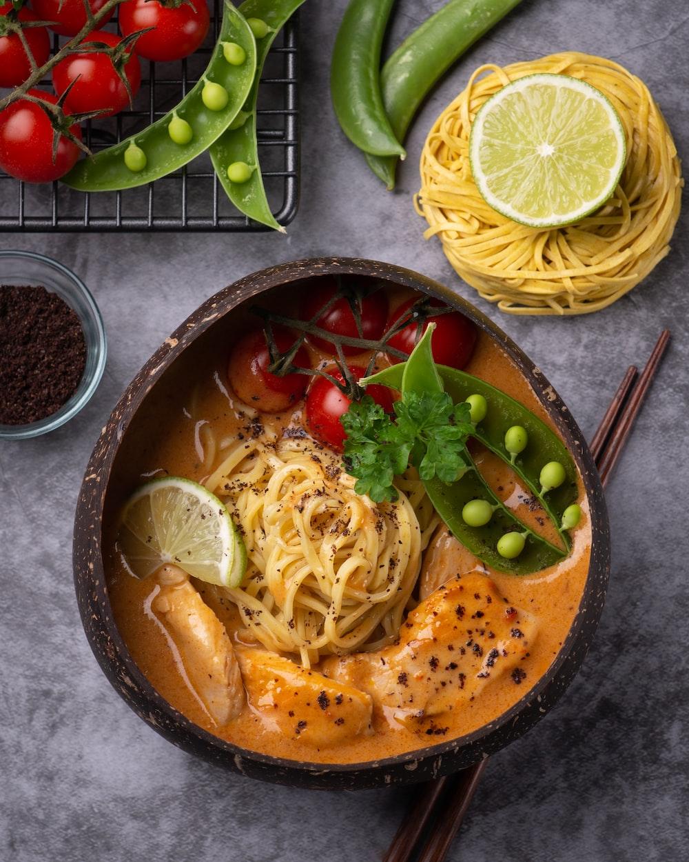 pasta dish on brown ceramic bowl
