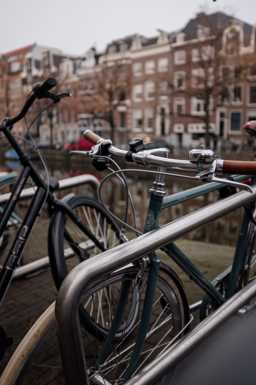 black bicycle on brown brick wall during daytime
