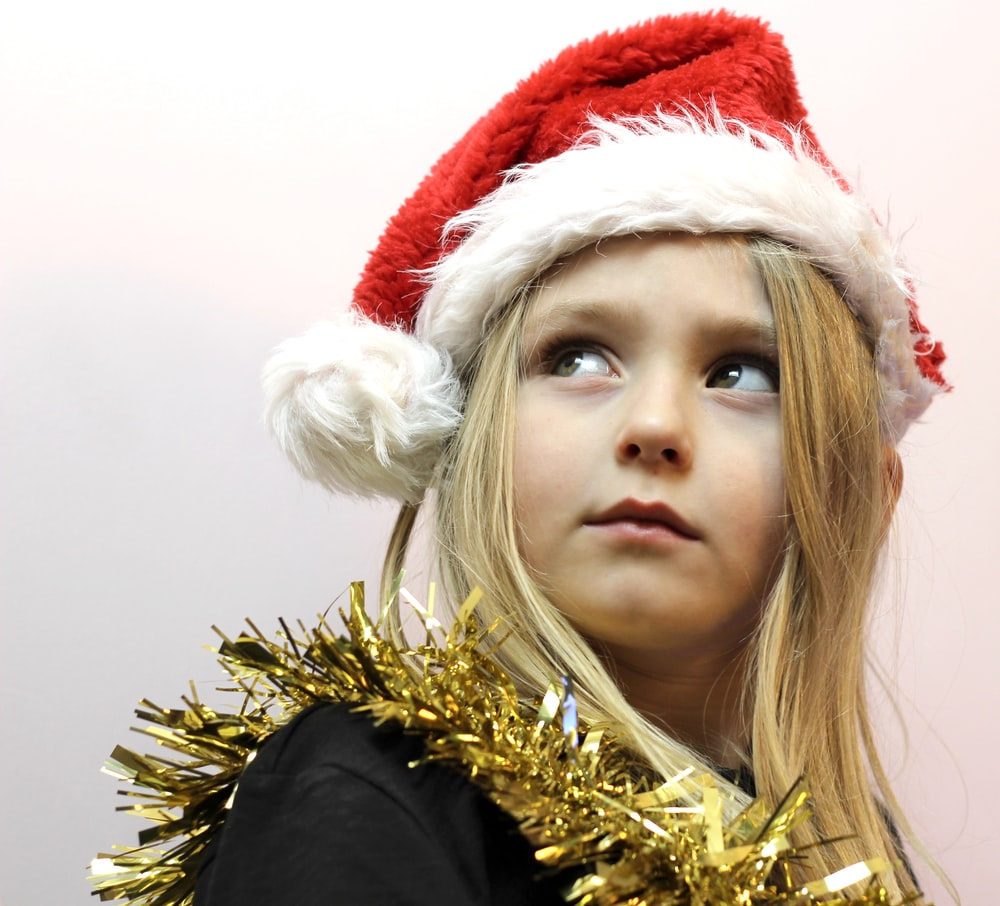 woman in red and white santa hat
