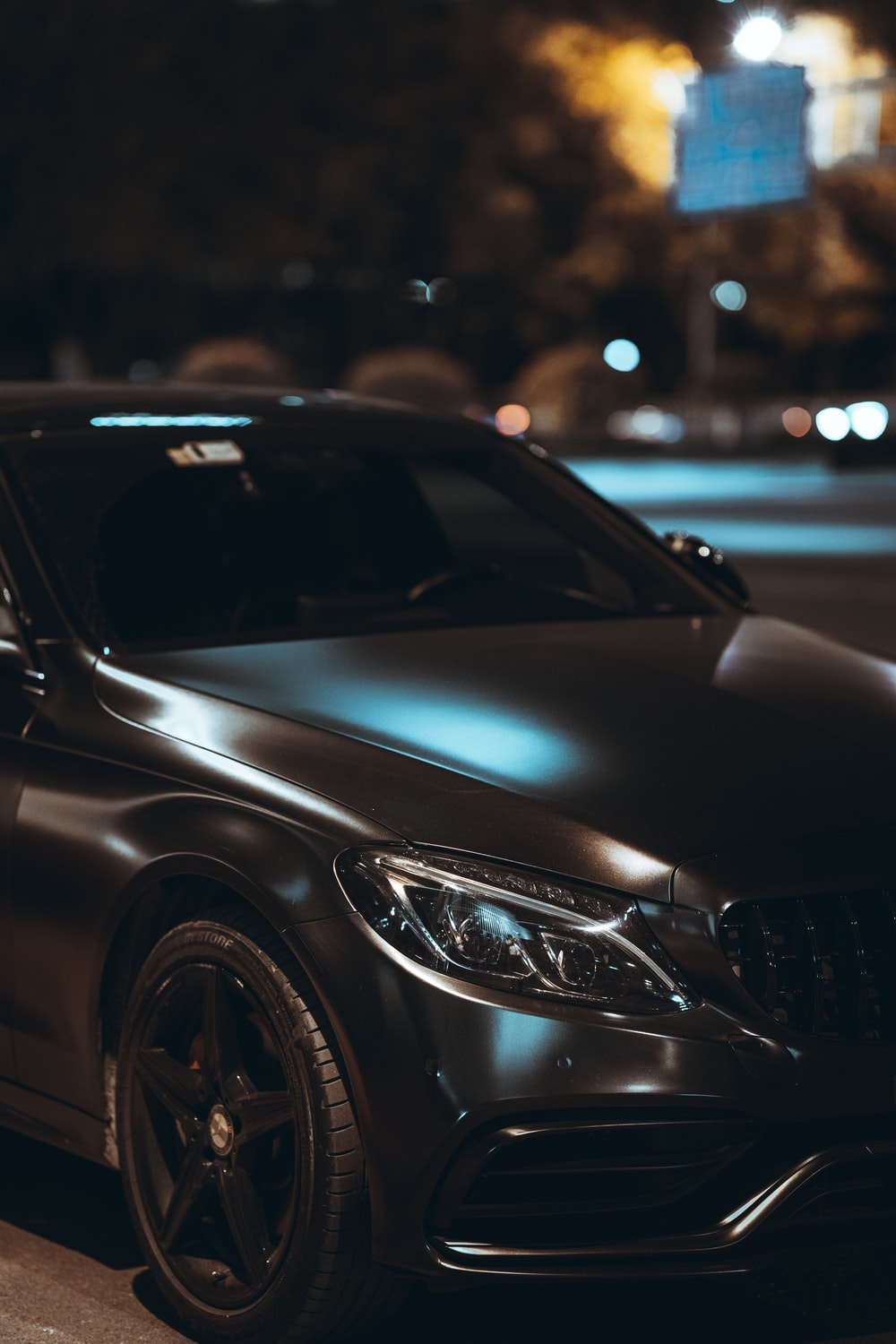 black mercedes benz c class on road during night time