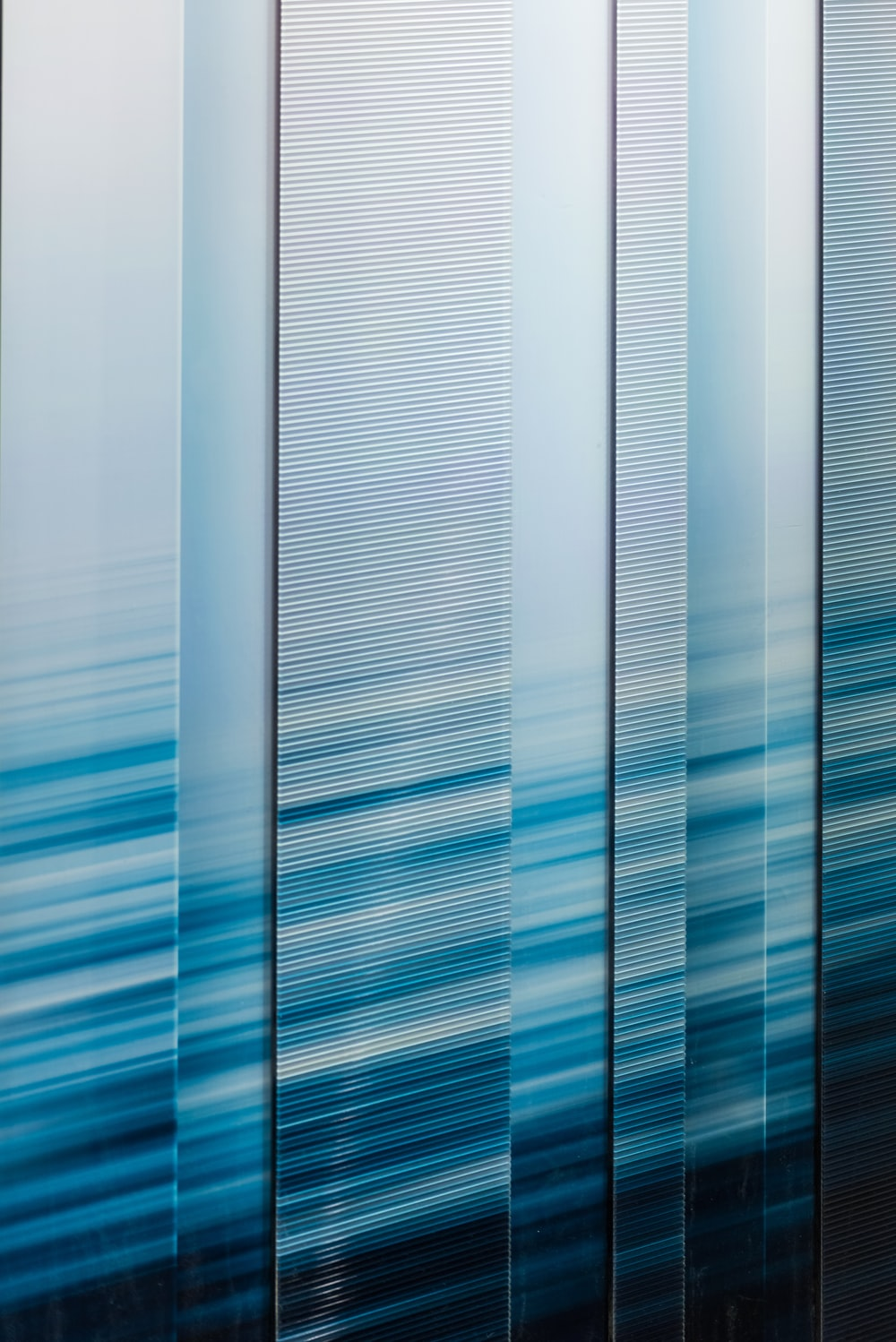 white blue and gray striped textile