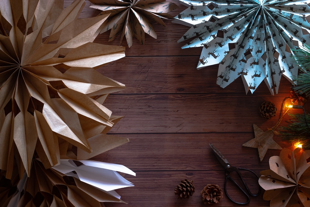 white paper boats on brown wooden floor