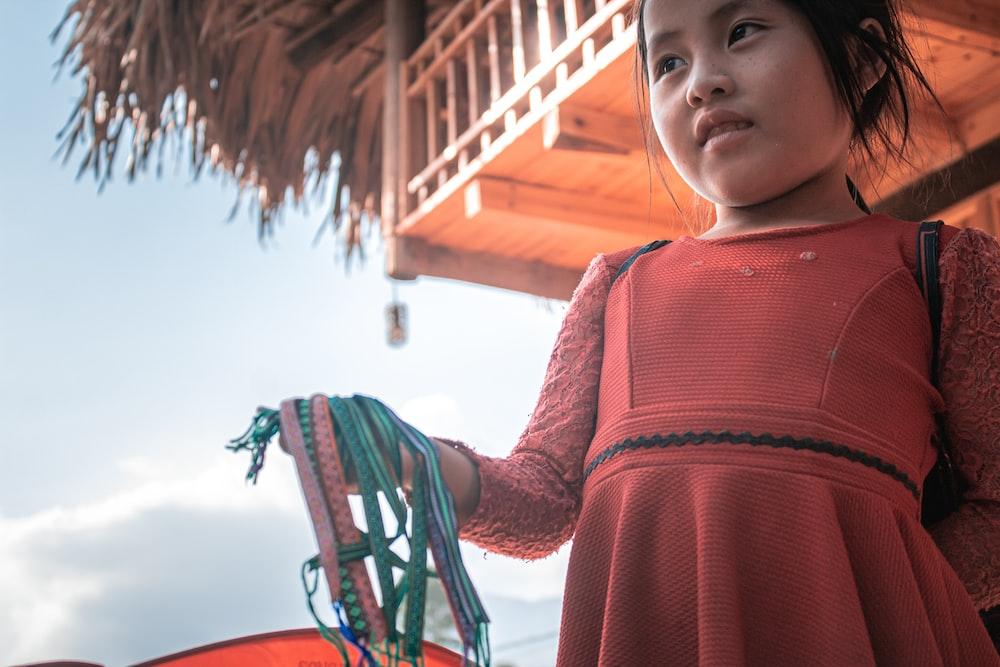 girl in red long sleeve shirt