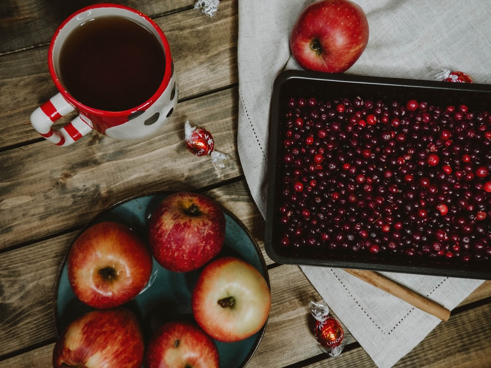 red apple fruit on black tray