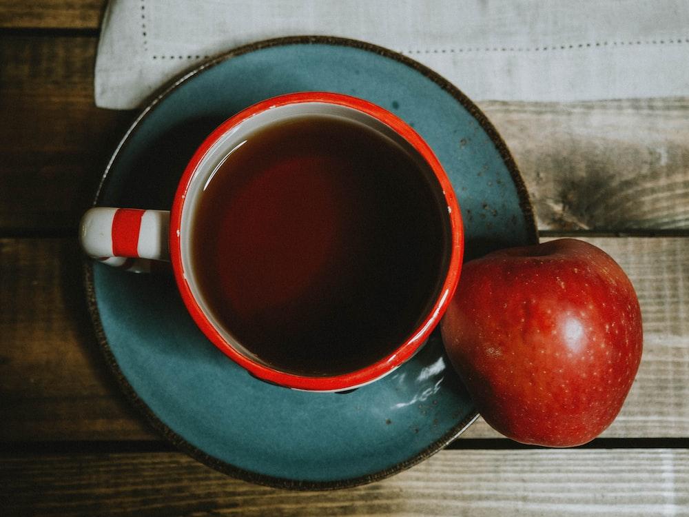 red apple on blue ceramic mug