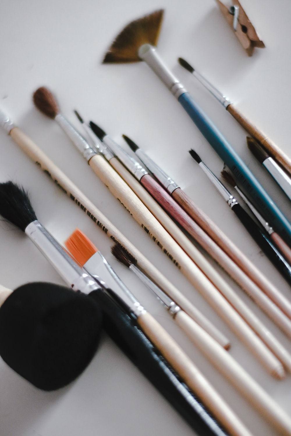 makeup brushes on white table