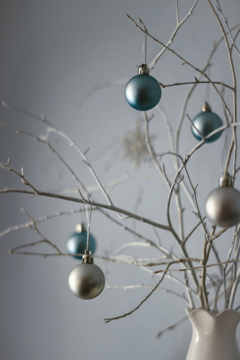 blue and white baubles on tree branch