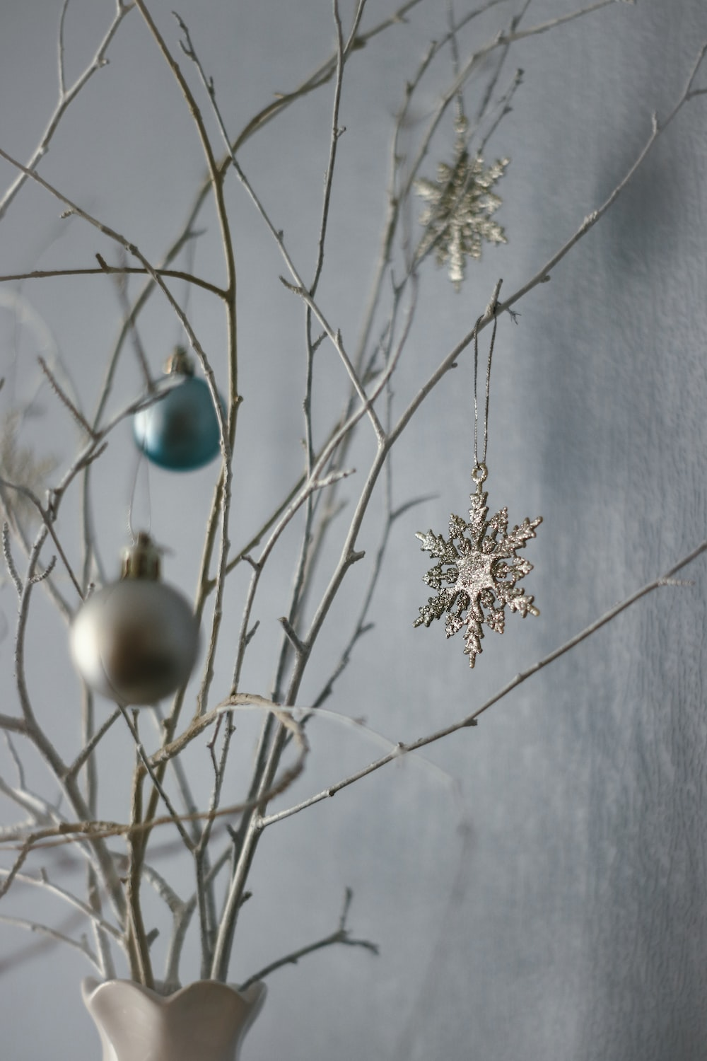 white and blue baubles on white tree branch