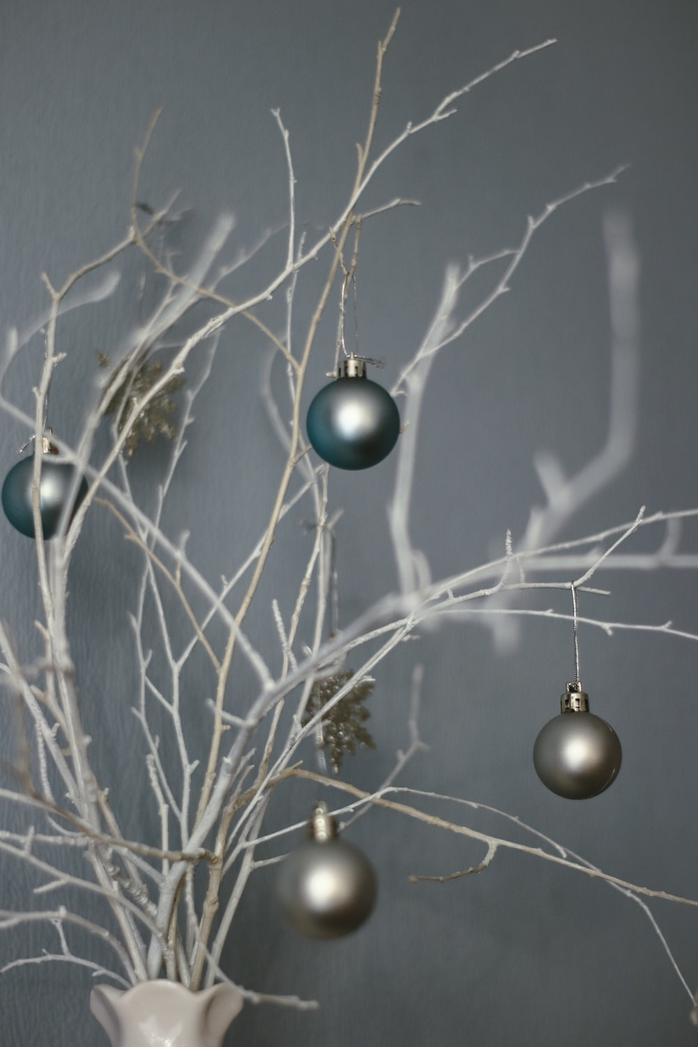 blue and silver baubles on brown tree branch