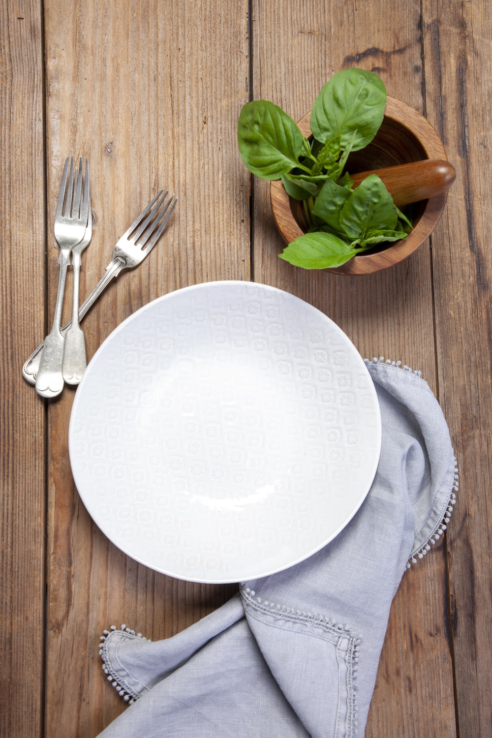 white ceramic plate beside stainless steel fork and bread knife