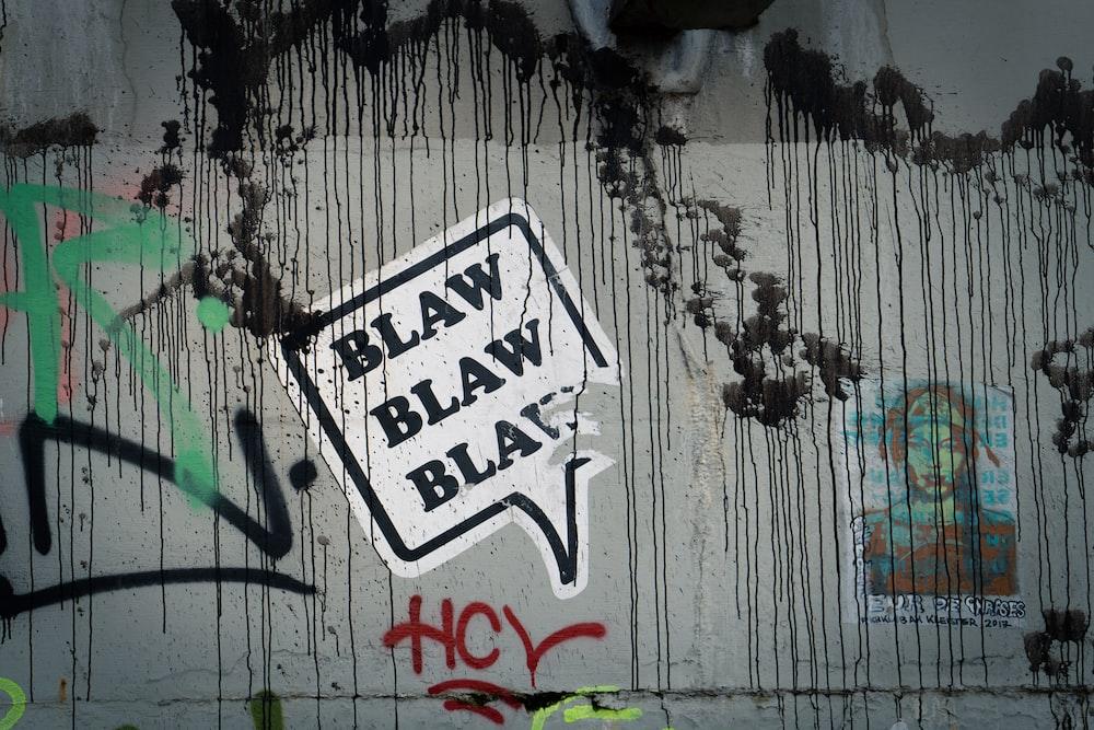 white and black graffiti on wall
