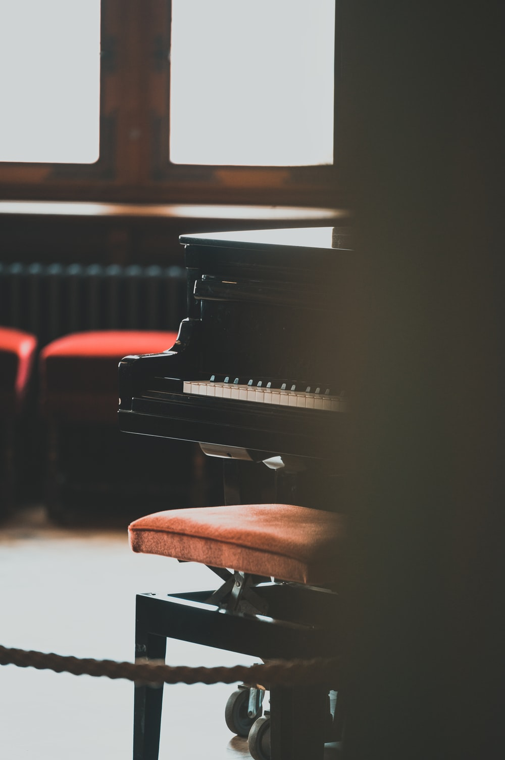 black wooden grand piano in close up photography