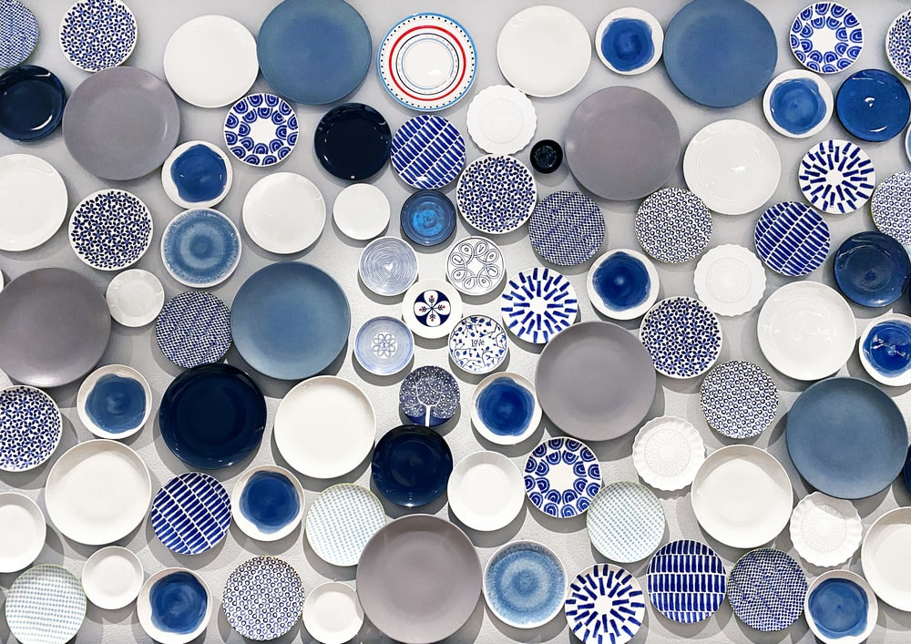 white blue red and yellow round ceramic plate