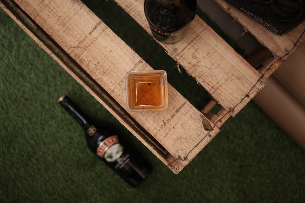 brown wooden box with bottles