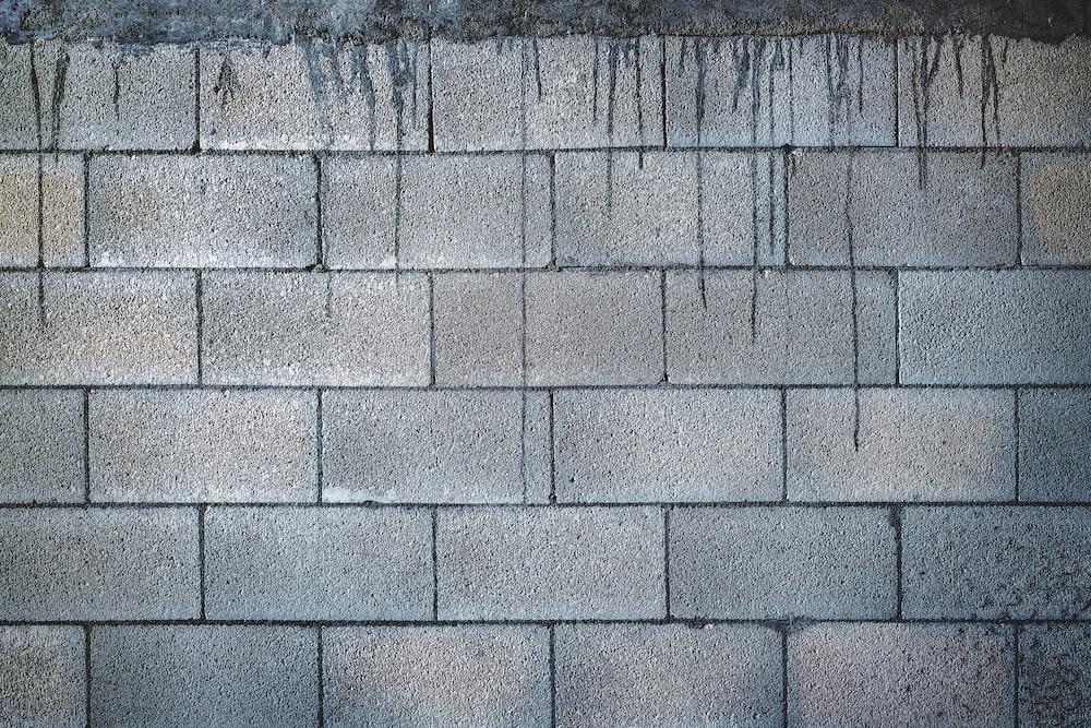 grey brick wall during daytime