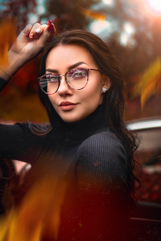 woman in black long sleeve shirt wearing black framed eyeglasses