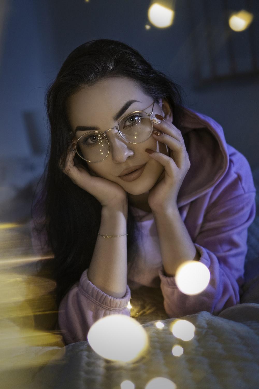 woman in pink hoodie wearing eyeglasses