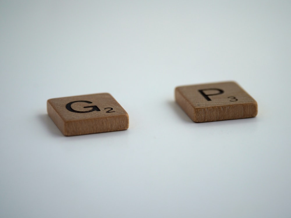 brown wooden dice on white surface