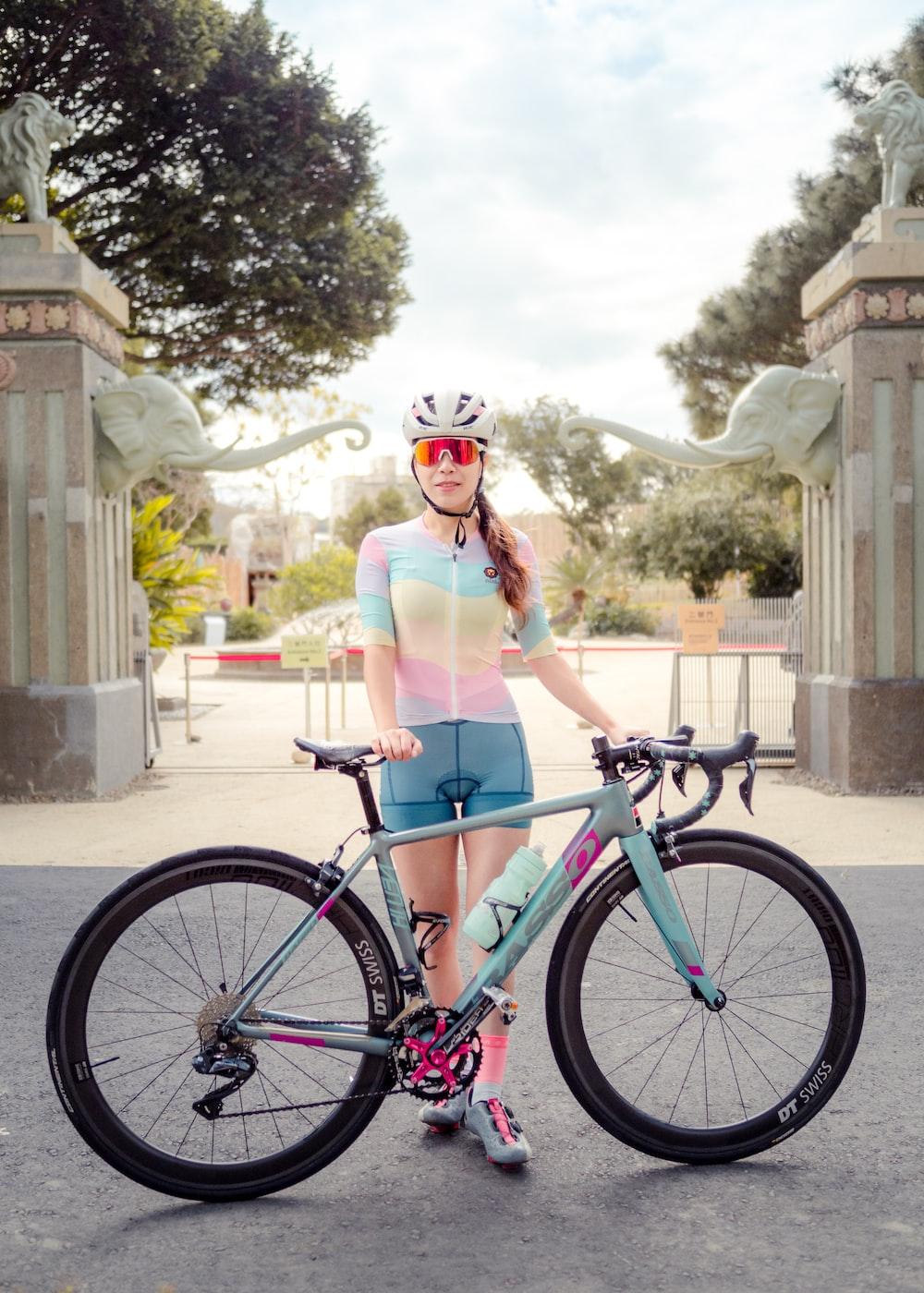 woman in pink bikini riding on bicycle