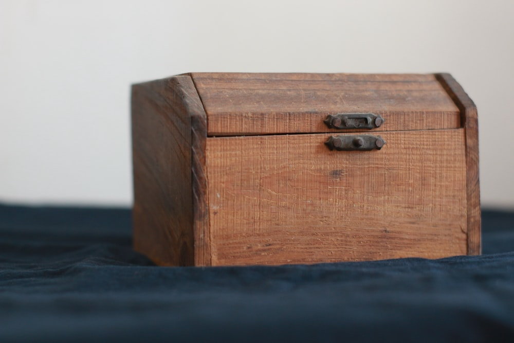 brown wooden chest box on black table
