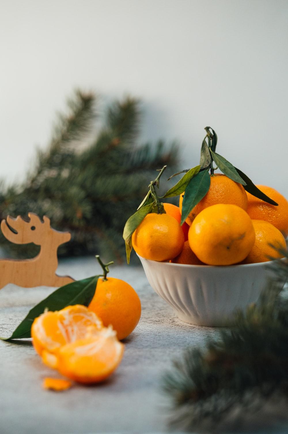 orange fruits on white ceramic bowl