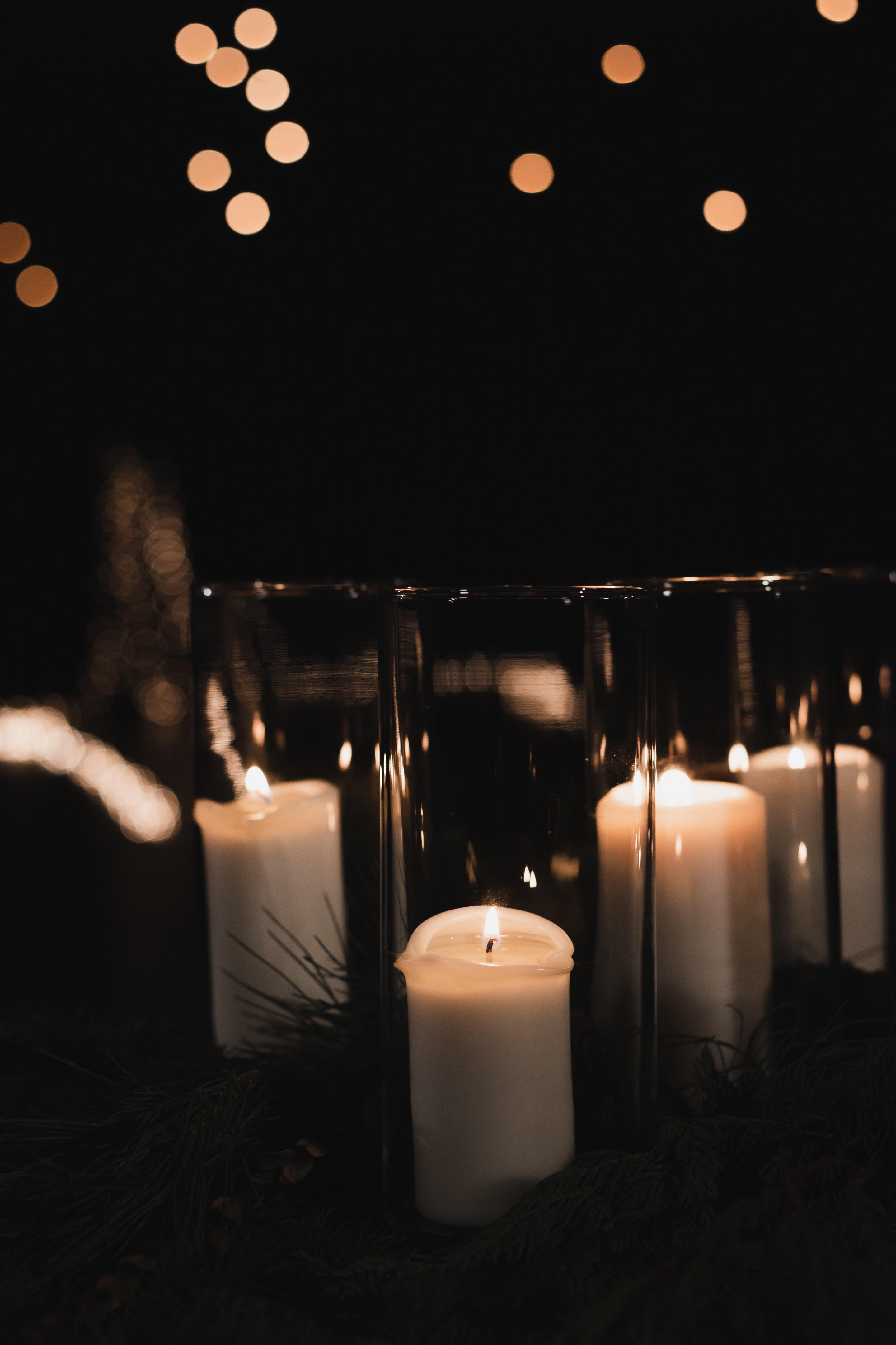 white pillar candles on black metal candle holder