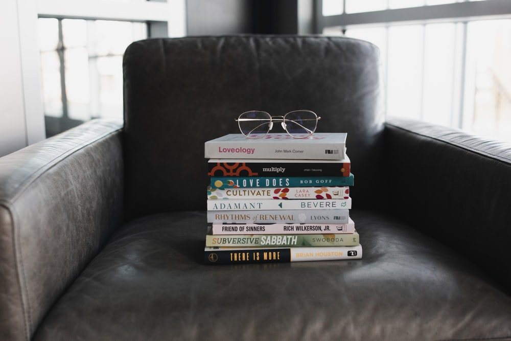 assorted books on black couch
