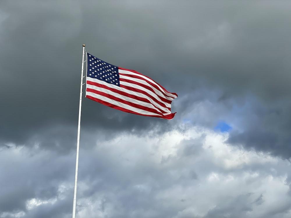 us a flag under cloudy sky