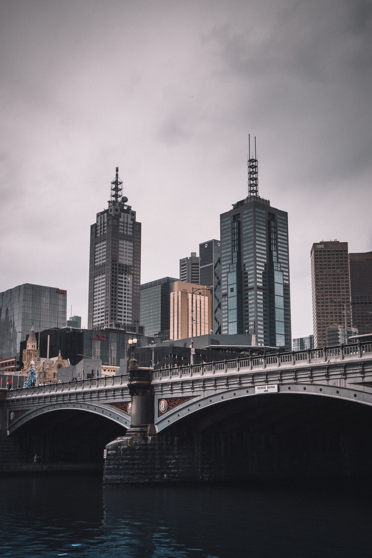 gray concrete bridge over city buildings during daytime