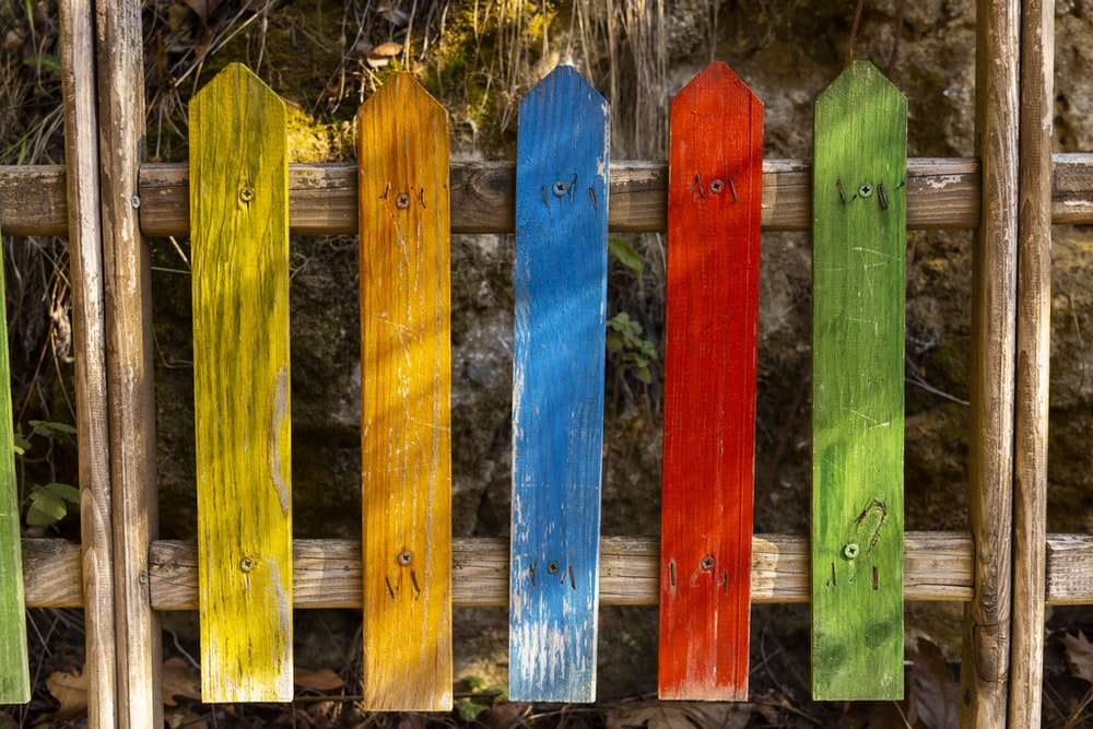 blue and yellow wooden fence