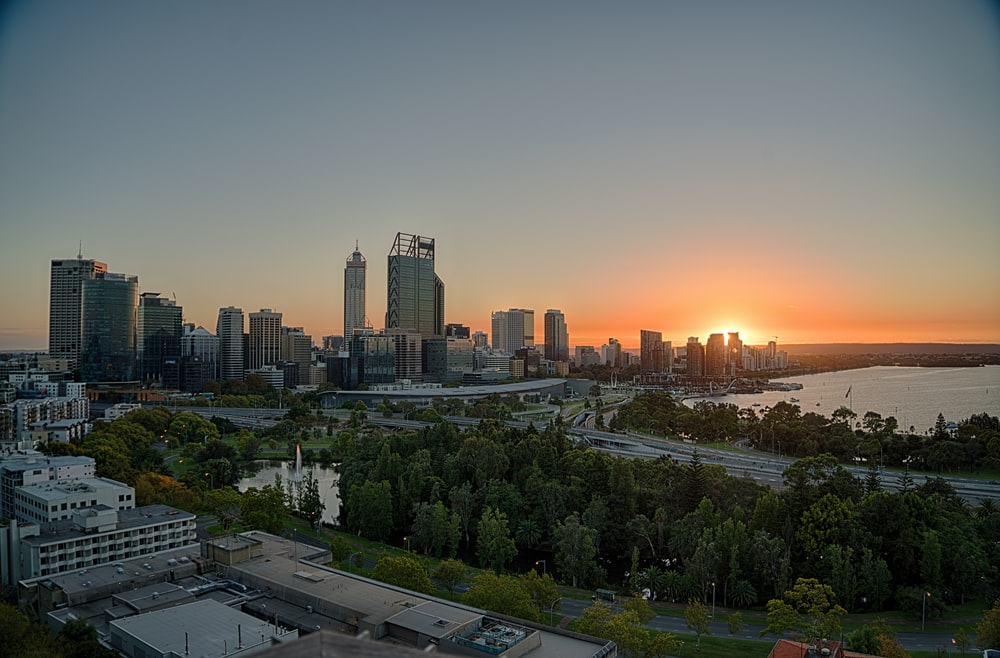 city with high rise buildings during sunset