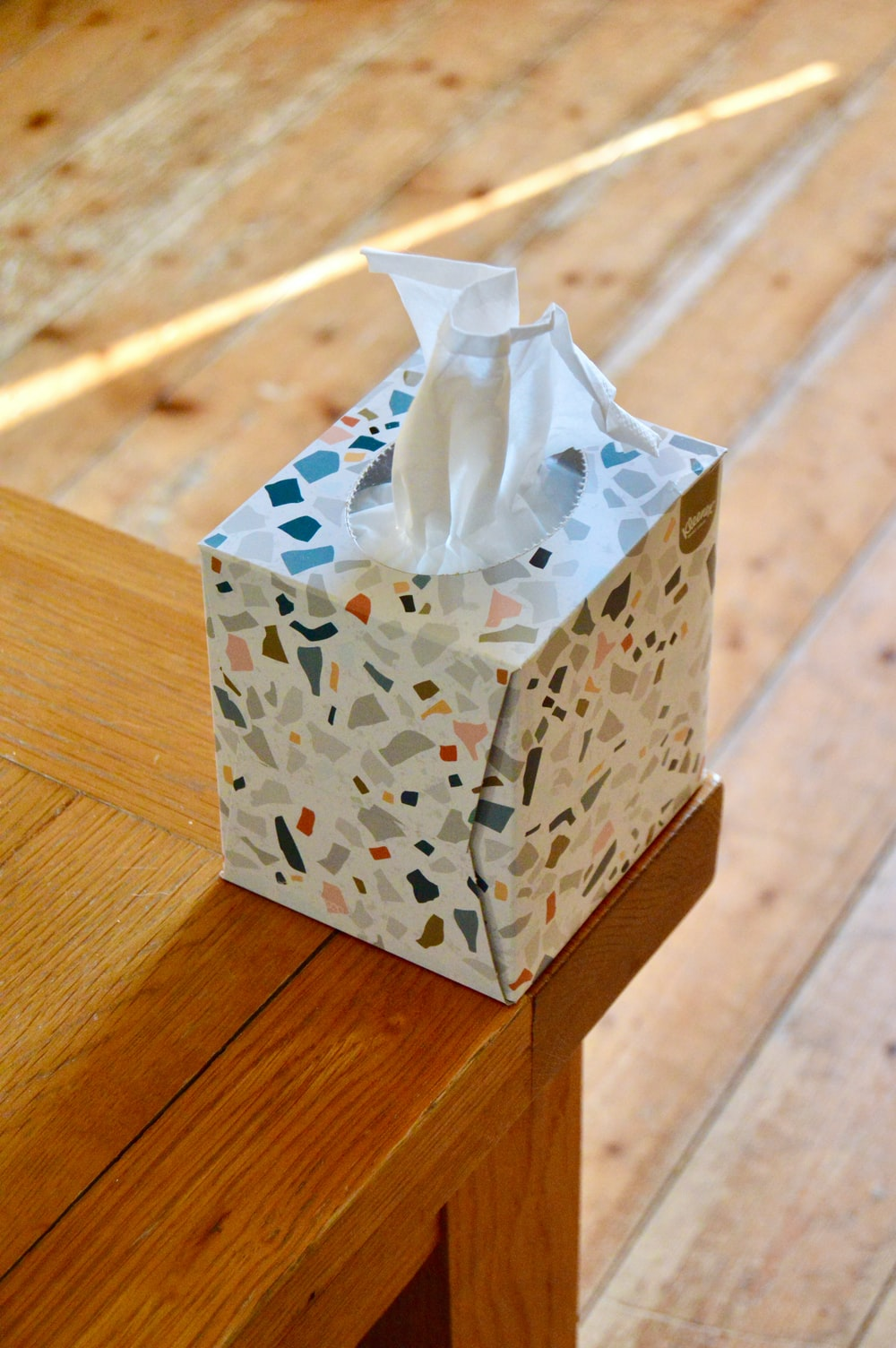 white and blue floral tissue box