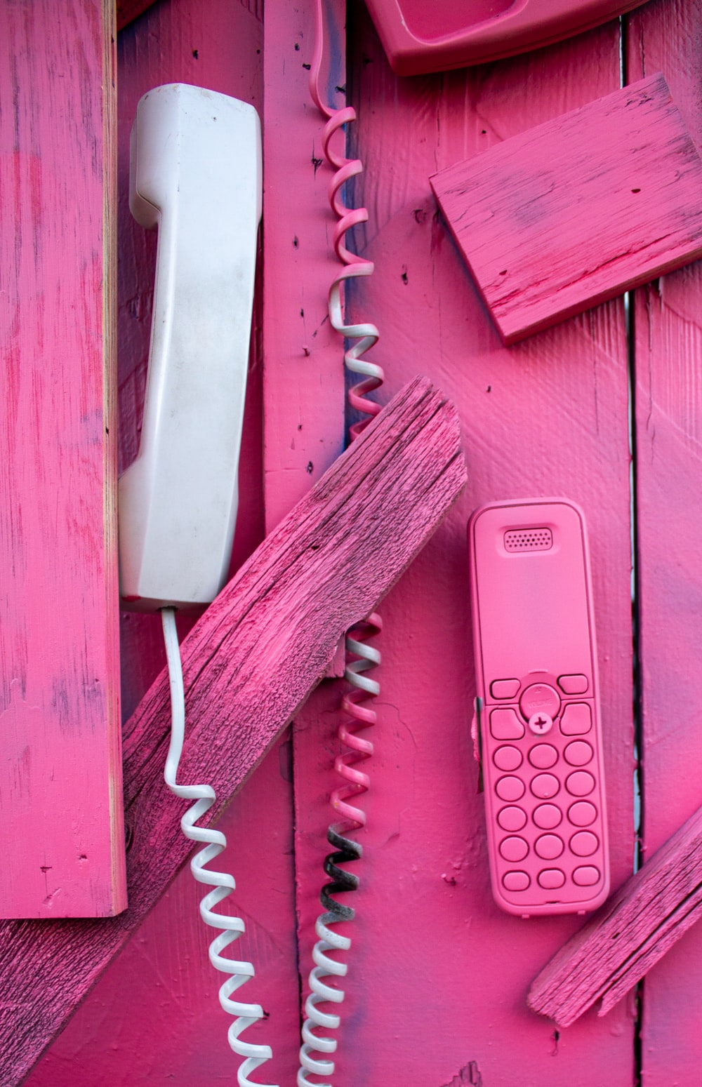 pink samsung smartphone beside green and white strap