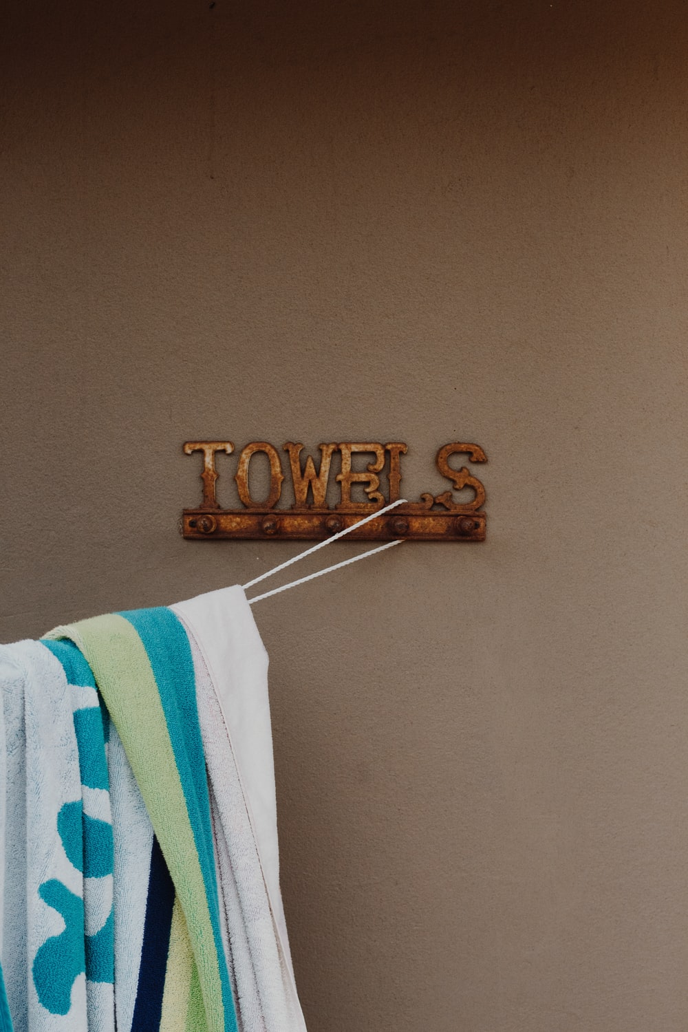 white and blue towel on white plastic hanger